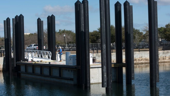 Workers at downtown Pensacola's Commendencia Street Pier prepare the city's new ferry landing on Monday, Jan. 29.  Passenger ferry service between downtown, Pensacola Beach, and Fort Pickens is expected to begin in mid-May.