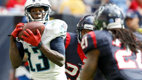 Titans wide receiver Kendall Wright catches a touchdown pass against the Texans on Nov. 30. Titans coach Ken Whisenhunt wants Wright to improve on his route-running.