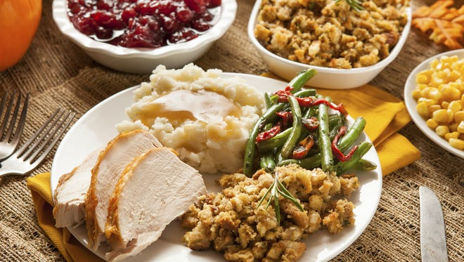 A homemade Thanksgiving dinner, complete with turkey and all the fixings.