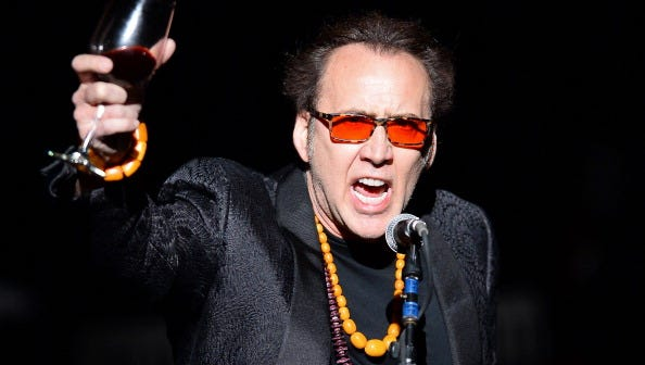 """LAS VEGAS, NV - MAY 21:  Actor Nicolas Cage introduces Guns N' Roses at The Joint inside the Hard Rock Hotel & Casino during the opening night of the band's second residency, """"Guns N' Roses - An Evening of Destruction. No Trickery!"""" on May 22, 2014 in Las Vegas, Nevada."""