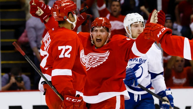 Detroit Red Wings center Joakim Andersson, center, celebrates a goal during the second period of Game 3 against the Tampa Bay Lightning on April 17, 2016.