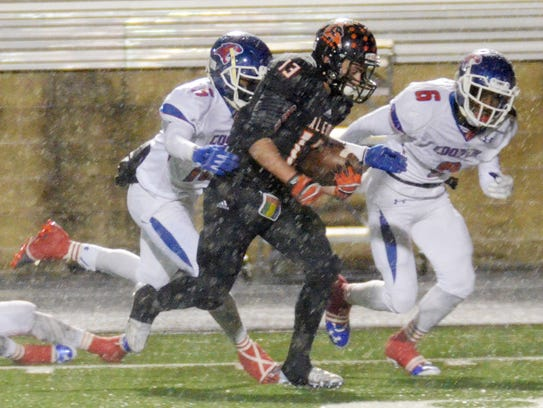 Aledo's Caleb Primera, center is chased down by Cooper's