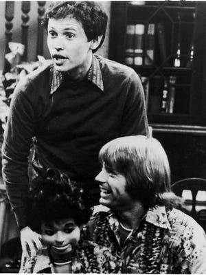"Billy Crystal, standing, and Jay Johnson, with dummy ""Bob,"" starred in ABC's sitcom 'Soap.' which premiered in 1977.  Crystal was network TV's first major gay character."
