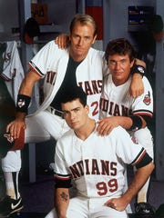 "In this 1989 image provided by Paramount Pictures, Tom Berenger, right, plays Cleveland Indians catcher Jake Taylor, Charlie Sheen, below, is the team's pitcher Ricky Vaughn, and Corbin Bernsen, above, plays third baseman Roger Dorn in the Paramount comedy ""Major League."""