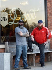 Michael Haddad and Shaun Walford pose for a photo outside of the Detroit Grooming Barber Shop.