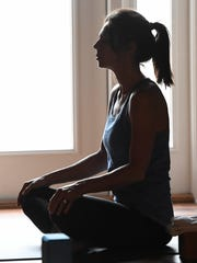 Tabitha Maloney in a meditative pose during a Yoga Alternative therapy class Saturday morning, March 25, 2017.
