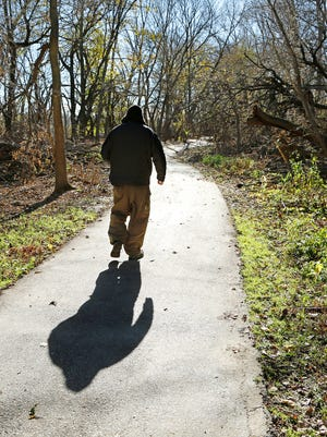 A homeless man walks along the Wabash Heritage Trail to an area where he had lived in a tent Thursday, November 19, 2015, south of Tapawingo Park in West Lafayette. The man said a trail manager from West Lafayette Parks and Rec removed his tent earlier in the month.