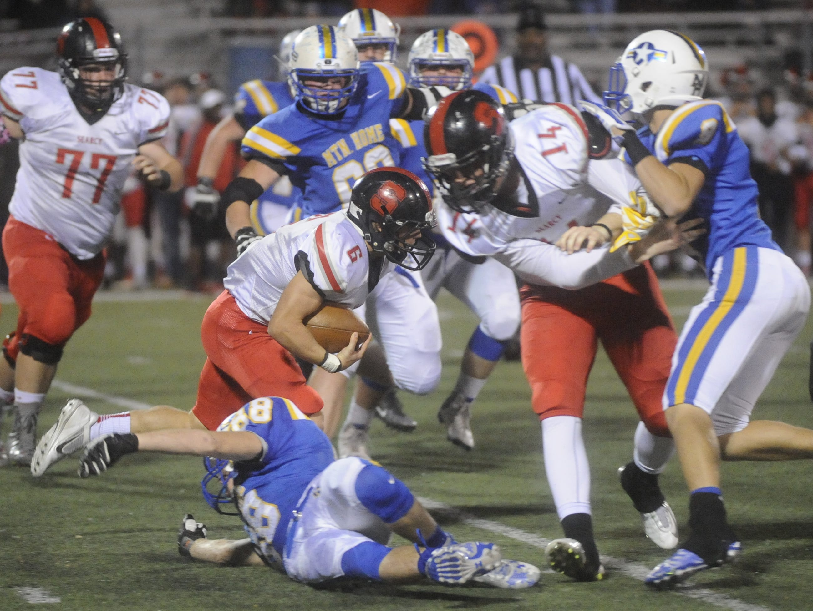 Searcy's Luke Dixon carries for a big gain during the Lions' 61-26 win over Mountain Home on Friday night.