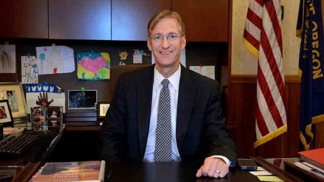 Oregon State Treasurer Ted Wheeler in his office at the Capitol Building on Monday, Sept. 8, 2014.