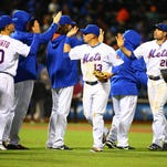 Apr 29, 2016; New York City, NY, USA; The New York Mets celebrate after defeating the San Francisco Giants 13-1 at Citi Field. Mandatory Credit: Andy Marlin-USA TODAY Sports