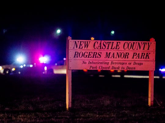 Members of the New Castle County Police Department investigate an apparent shooting near Rogers Manor Park near New Castle on Wednesday night.