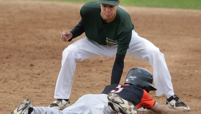 Green Bay Preble High School's Connor Lemmens tags out Burlington High School's Grant Tully at second base during their WIAA Division 1 semifinal state baseball game Tuesday, June 14, 2016, at Neuroscience Group Field at Fox Cities Stadium in Grand Chute, Wis.  Wm. Glasheen/USA TODAY NETWORK-Wisconsin