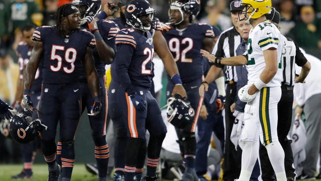 Green Bay Packers quarterback Aaron Rodgers (12) has words with Chicago Bears inside linebacker Danny Trevathan (59) after Trevathan was called for a person foul after putting a hit on wide receiver Davante Adams Thursday, September 28, 2017, at Lambeau Field in Green Bay, Wis.