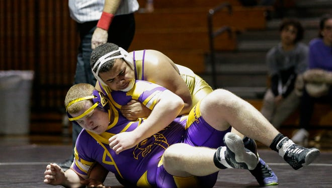 Two Rivers' Damien Bullock against Sheboygan Falls' Scott Klemme in a 285 pound match at Two Rivers High School Thursday, Dec. 7, 2017, in Two Rivers, Wis. Josh Clark/USA TODAY NETWORK-Wisconsin