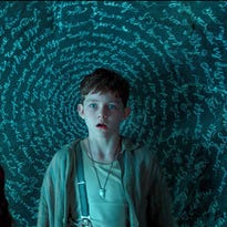 """This photo provided by courtesy of Warner Bros. Pictures shows, Rooney Mara, left, as Tiger Lily, and Levi Miller as Peter, in a scene from the film, """"Pan."""" The movie releases in U.S. theaters on Friday, Oct. 9, 2015. (Warner Bros. Pictures via AP)"""