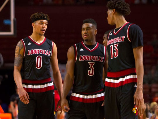 Jan 10, 2016; Clemson, SC, USA; Louisville Cardinals guard Damion Lee (0) guard Trey Lewis (3) and forward Raymond Spalding (13) react during the second half against the Clemson Tigers at Bon Secours Wellness Arena. Tigers won 66-62. Mandatory Credit: Joshua S. Kelly-USA TODAY Sports
