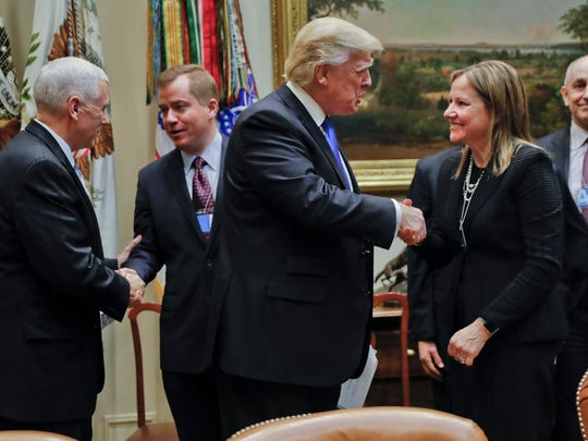 President Donald Trump, greets GM CEO Mary Barra, right,