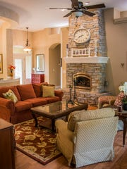 Rock details and warm colors bring the living room in the Lollar home to life.