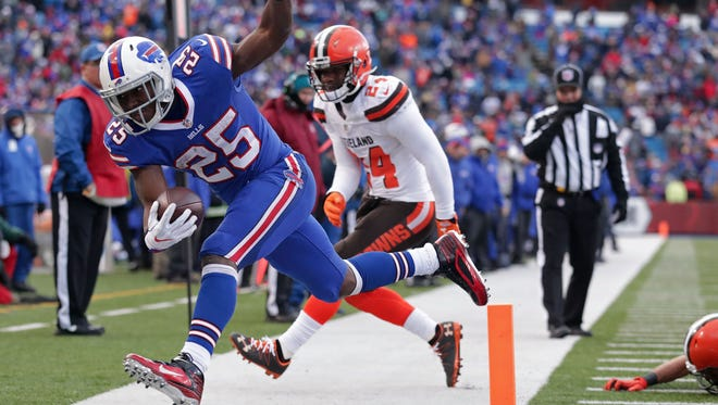 ORCHARD PARK, NY - DECEMBER 18:  LeSean McCoy #25 of the Buffalo Bills scores a touchdown against the Cleveland Browns during the second half at New Era Field on December 18, 2016 in Orchard Park, New York.  (Photo by Brett Carlsen/Getty Images)