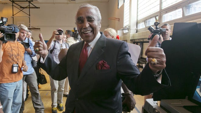 Congressman Charles Rangel, D-N.Y., flashes a thumbs-up after voting in the congressional primaries, Tuesday, June 24, 2014, in New York. Rangel, 84, one of the most recognizable members of the Congressional Black Caucus, faces multiple challengers in his primary as he aims for a 23rd term representing demographically shifting areas of New York City. Rangel's top challenger is state Sen. Adriano Espaillat, who would become the first Dominican-born member of Congress.