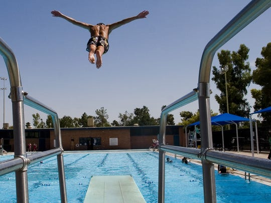 Cole Glanzer, 14, of Phoenix, dives in to the Encanto