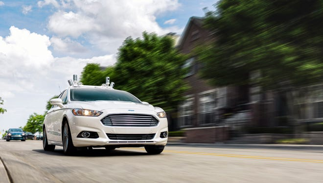 Ford will make a driverless car for ride-sharing purposes by 2021, using its Ford Fusion Hybrids (shown here) as technology test mules.