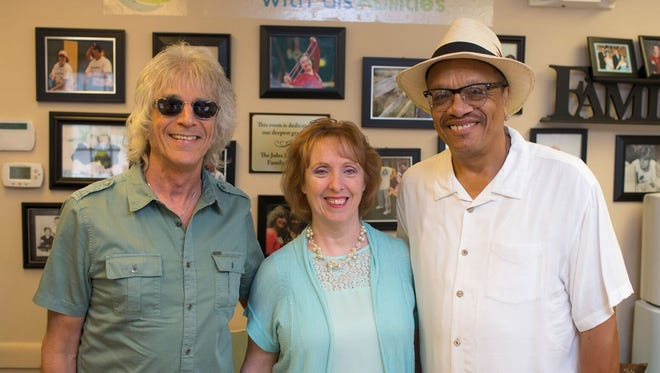 Pictured from left to right are Myke Scavone (Yardbirds), Nancy Phalanukorn (of FRA) and Chuck Lambert.
