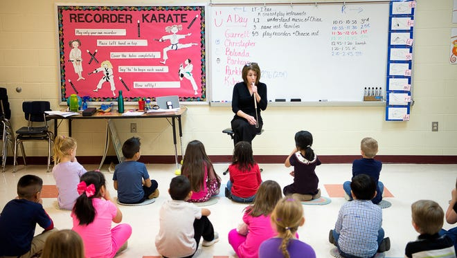 Music teacher Julie Ledford uses a whistle to produce a series of pitches while students recite it back during a music lesson  in February at Fletcher Elementary School. School officials say a coming limit on class size in early grades would result in less instruction in subjects like art, music and physical education unless legislators take action.