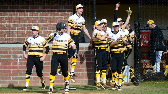 Murphy players leave the dugout to celebrate a homerun during their game at Rosman High School on Friday, March 16, 2018. The Bulldogs defeated the Tigers 18-3 in five innings.