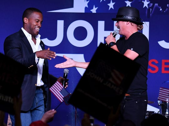 Rob Ritchie, aka Kid Rock, right, introduces John James at a 'Mission: Take Back Michigan Rally' at Suburban Showcase in Novi, Mich. on June 12, 2018.