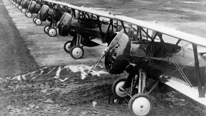 This group of Boeing pursuit planes was delivered to United States army fliers on January 28, 1932 for use at Selfridge Field. This ships are equipped with the new type cowling, designed to increase speed by decreasing wind resistance. The group in the photograph represent an investment of close to half a million dollars.