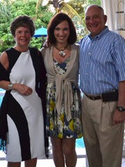 Sarah McBride, 22, is shown with parents Sally and