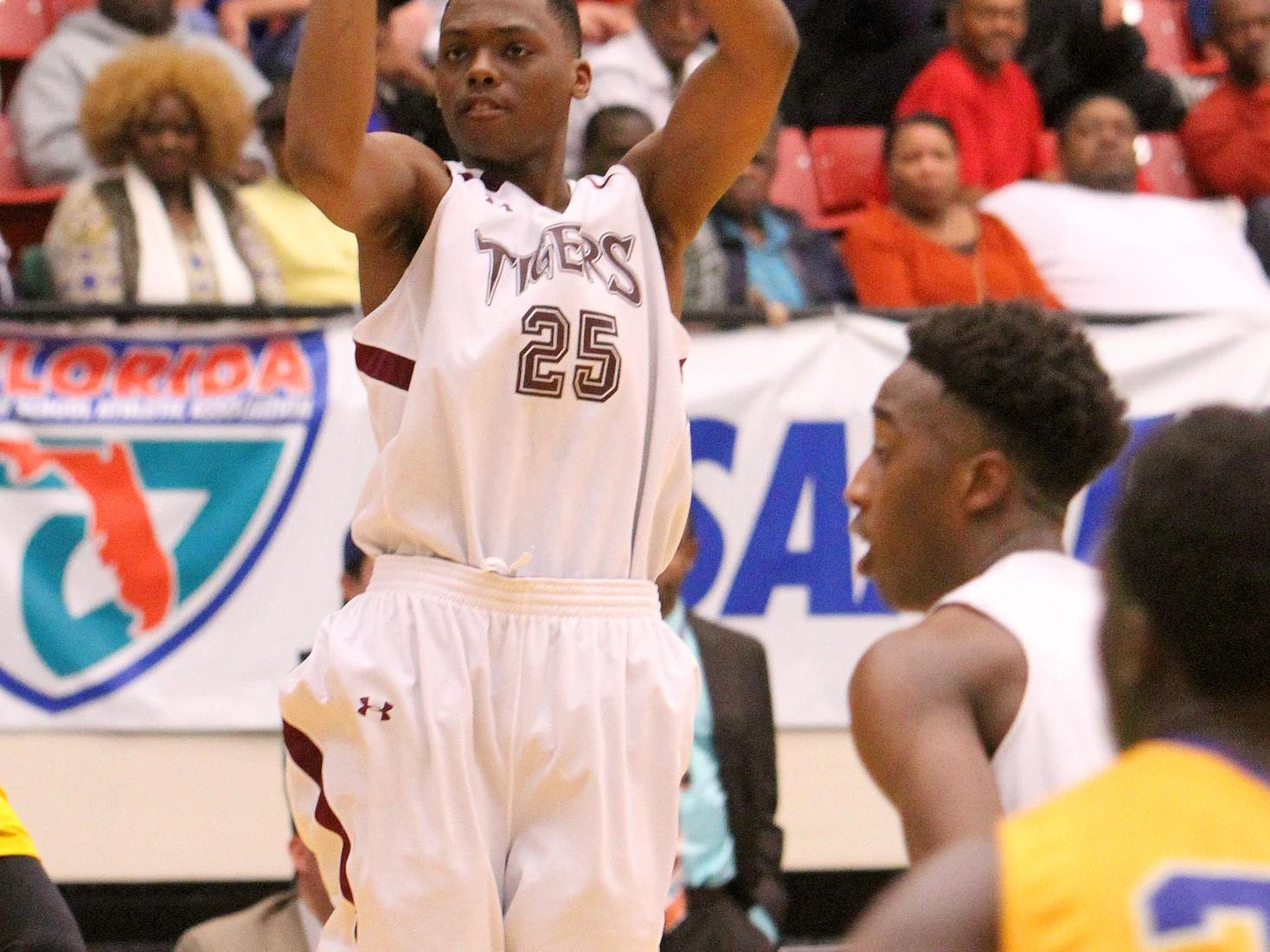 Pensacola Javon Grimsley goes up uncontested for a basket against Largo during the FHSAA 6A semi final Friday February 26, 2016 in Lakeland, Florida. Pensacola lost the match 54-56. Photos by Cindy Skop 2016