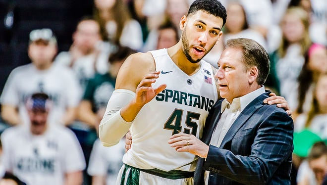 Denzel Valentine ,left, of MSU and MSU Men's Basketball Head Coach Tom Izzo have a discussion as freethrows are shot in the 1st half of their game with Rutgers.