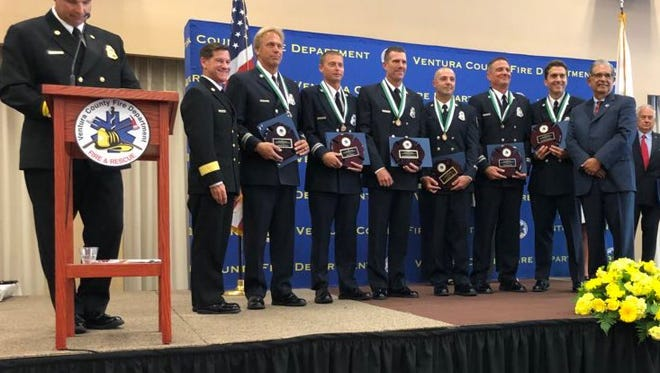 The members of Ventura County Fire Department  Swiftwater Rescue Team 154 are honored with lifesaving medals for their role in the rescues of three people during a rainstorm in February 2017.