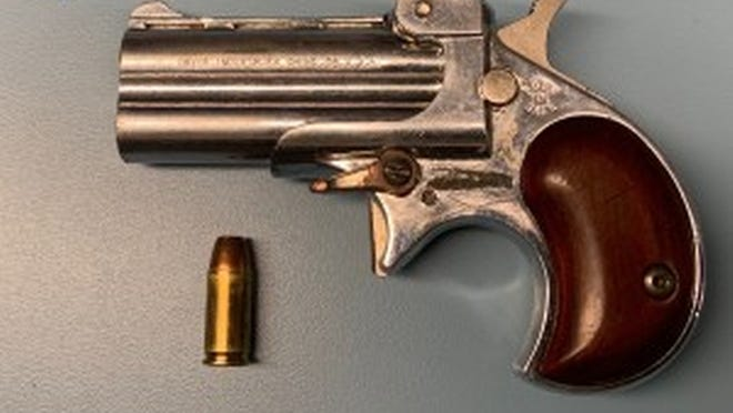 State police released this photo of the pistol found during a Worcester traffic stop.