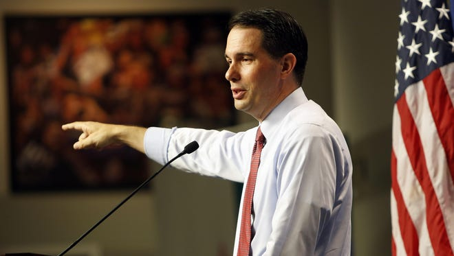 Gov. Scott Walker speaks during a campaign stop Friday in Manchester, N.H.