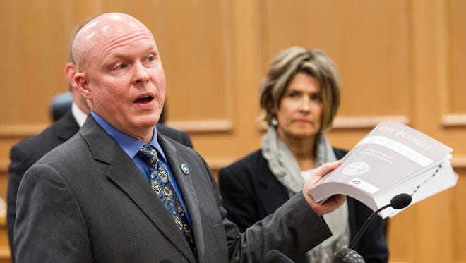 Republican Rep. David Hawk of Greeneville presents his proposal to boost transportation without a gas tax during a news conference Wednesday, Feb. 1, 2017, at the legislative office complex in Nashville. Rep. Terri Lynn Weaver, R-Lancaster, looks on at right.