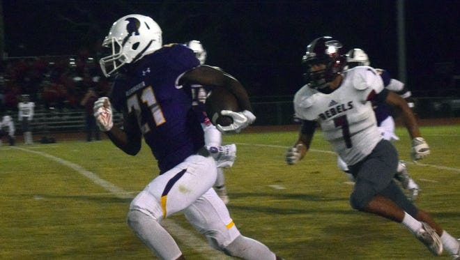 ASH defensive back Bud Clark (21) runs for yards against Pineville during the 2017 season. Clark was named to the 2018 LSWA Class 5A team.