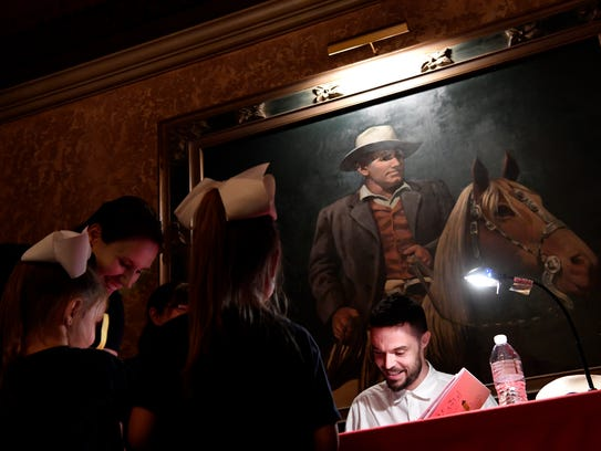 Author Oliver Jeffers signs books at the Paramount Theatre Thursday. Jeffers' work was honored in this year's Children's Art & Literacy Festival.