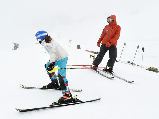 Ski development program racer Lauren Palermo charges into a slalom course under the watchful eyes of coach Sean Higgins during a training session at Squaw Valley Ski Area near Truckee, Calif. on Jan. 16, 2015.