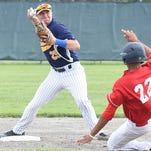 Michigan Rams second baseman Alex Peczynski turns a double play during a game earlier this summer.
