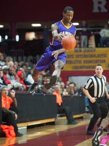 Camden's Deaquan Williams leaps to keep a ball in bounds