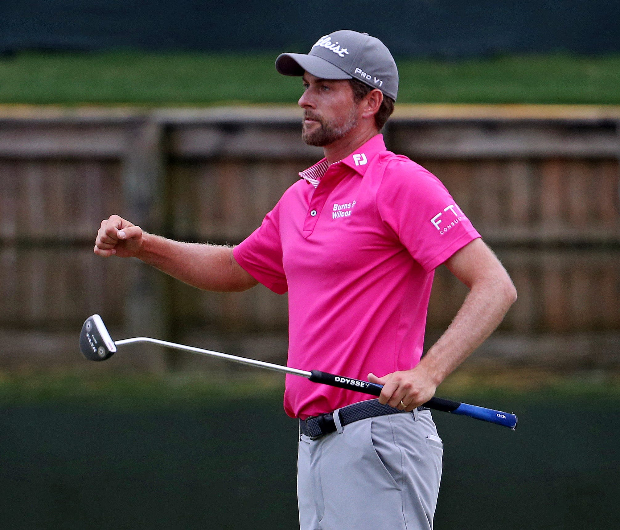Webb Simpson celebrates winning The Players Championship.