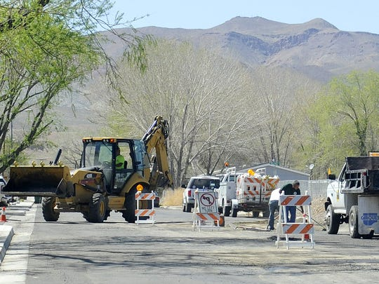 Public Works crews fill in potholes on South Street.