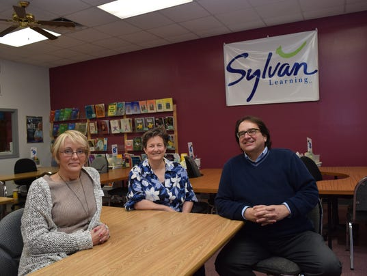 Terri Harmeyer (center) and her husband Thomas Harmeyer are the new owners of Sylvan Learning Center located on Texas Avenue near the corner of Jackson Street. Sharlene Stinson (left) is associate director of the center.