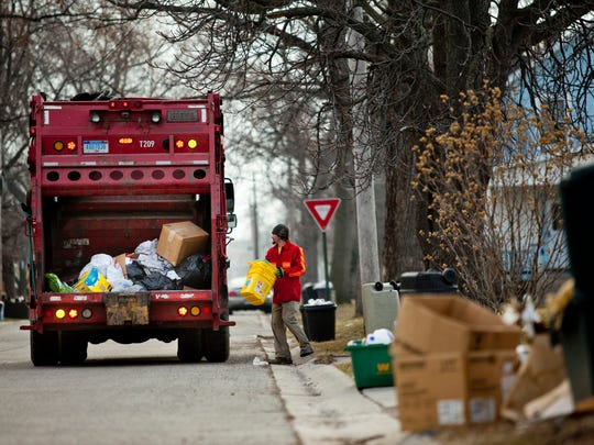 Marcotte Disposal workers collect garbage from the