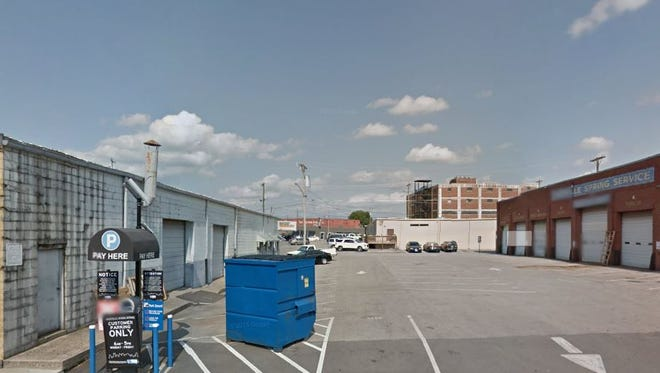 The property Tim Reynolds bought includes this parking lot at 602 Ninth Ave. S. and two industrial buildings.