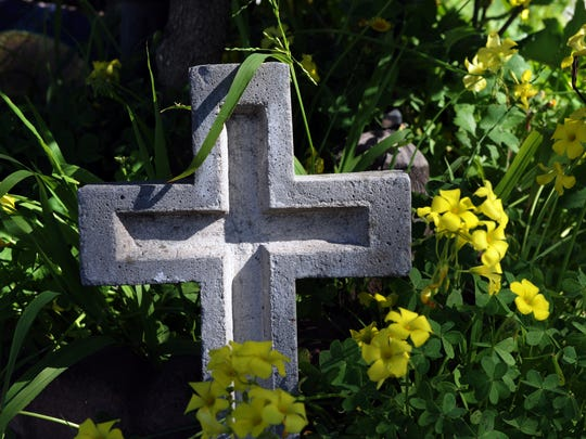 A simple cross at the foot of the Becerra home's driveway in Salinas.