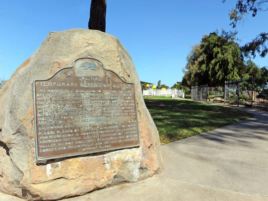 A plaque in Sherwood Park, Salinas, CA with information about Japanese-Americans who were interned in the area during WWII. The city and part of the nearby Day of Remembrance Memorial Garden sustained heavy damage during a freak windstorm in February.